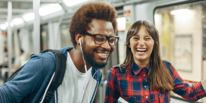 white-woman-black-man-laughing-on-train